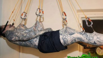 Guy Suspended with Hooks